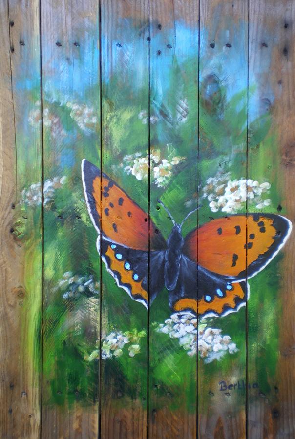 vlinder op hout